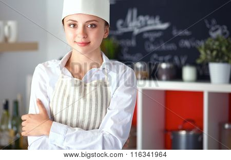 Chef woman portrait with  uniform in the kitchen