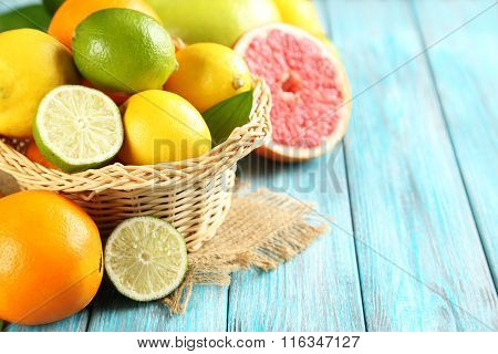 Citrus Fruits On A Blue Wooden Table