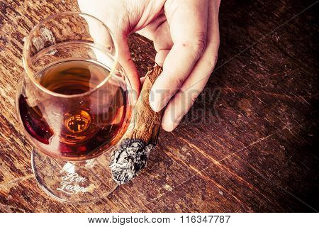 Cigar In Man Hand With Glass Of Alcohol