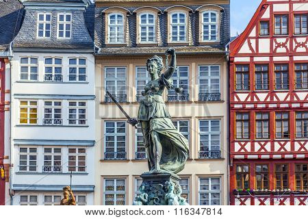 FRANKFURT, GERMANY - MAY 3, 2014: Statue of Lady Justice in front of the Romer in Frankfurt - Germany