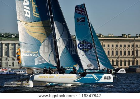 ST. PETERSBURG, RUSSIA - AUGUST 21, 2015: Extreme 40 catamarans during the 2nd day of St. Petersburg stage of Extreme Sailing Series. Red Bull Sailing Team of Austria leading after the 1st day