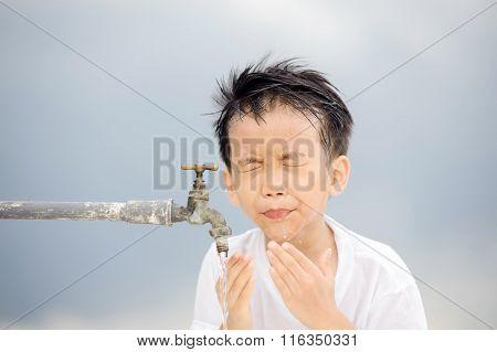 Boy wash his face