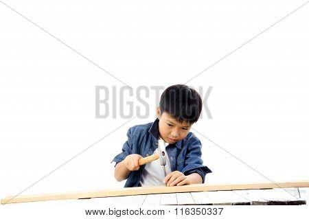 Boy Put Nail On Wood