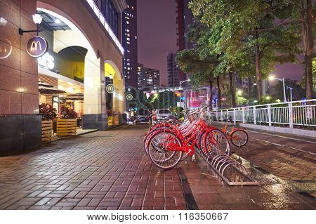 SHENZHEN, CHINA - JANUARY 22, 2016: McDonald's restaurant exterior at night. McDonald's is the world's largest chain of hamburger fast food restaurants