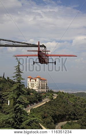 Barcelona, Catalonia, Spain - August 29, 2012: Red Aeroplane And Gran Hotel La Florida Near Tibidabo