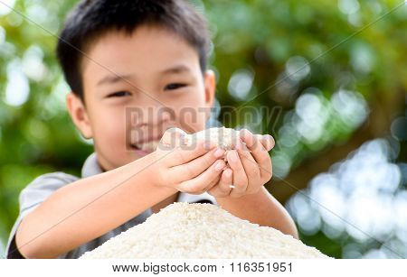 Jasmine Rice In Kid Hand