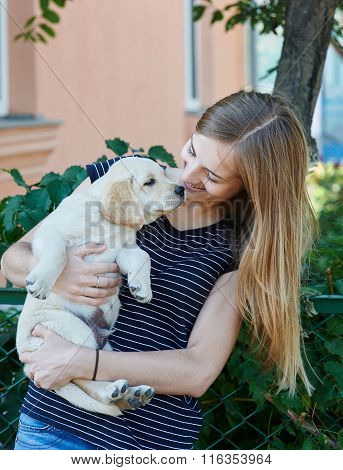 Woman Is Holding A Puppy Dog Breed Labrador