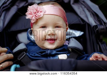 Baby girls smiling face, close-up outdoor