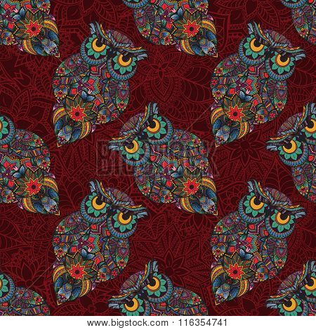 Vector illustration of owl. Bird illustrated in tribal.Owl with flowers on dark background.