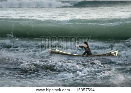 Businessman Pointing Sitting On Money Boat In Ocean With Waves