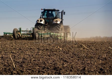 Closeup Backside Cultivator Raises Great Dust On Ploughed Soil