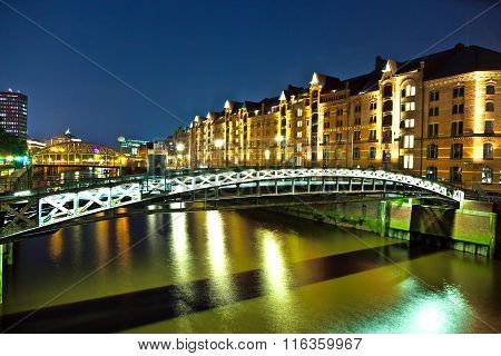 HAMBURG, GERMANY APR 3, 2012: Speicherstadt In Hamburg with canal by night
