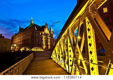 iron bridge at Speicherstadt in Hamburg by night