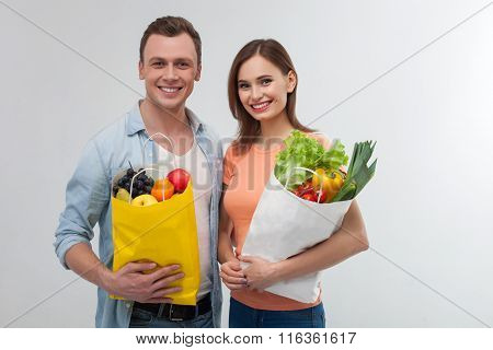 Attractive loving couple is buying natural products