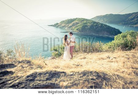 Young Couple In Love Enjoying The View On A Cape In Thailand