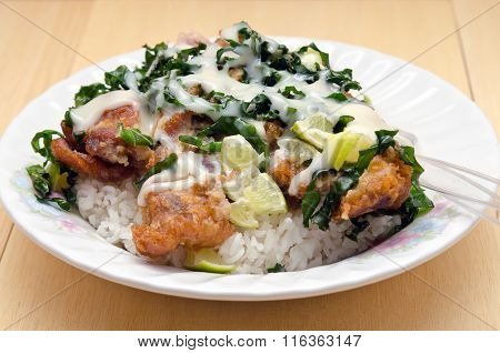 Fried Chicken With Lemon Sauce And Herb Over Rice (famous Thai Food)
