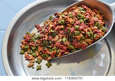 pet food in iron scoop on weighing scale tray
