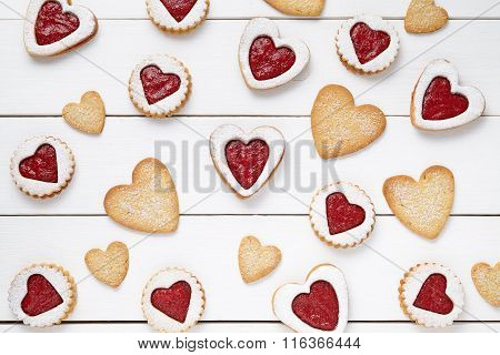 Heart shaped and shortbread cookies with jam gift composition for Valentines Day on vintage wooden b