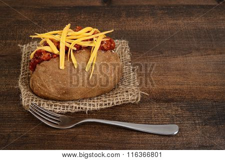 chili and cheese potato with fork