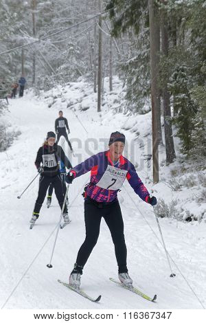 Group Of Cross Country Skiing Woman In The Beautiful Pine Forest