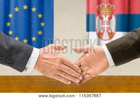 Representatives Of The Eu And Serbia Shake Hands
