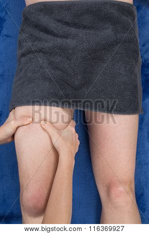Female Therapist Applying Pressure On Fmale Hamstrings
