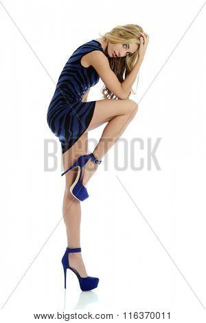 Fashion woman wearing a blue dress and high heels isolated on a white background