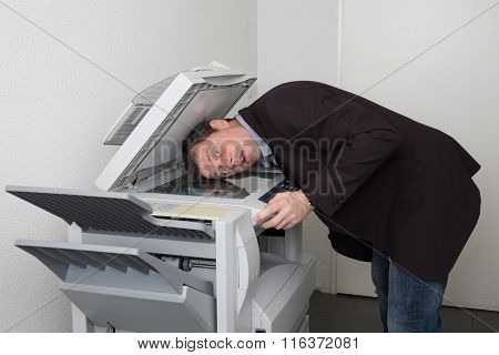 Business Male In Trouble With The Copy Machine At Work