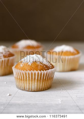Cupcakes On A Wooden Table
