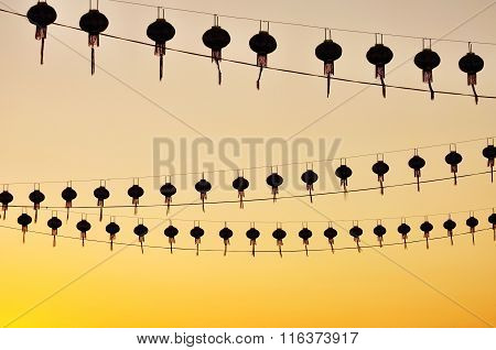 Silhouettes Of Chinese Lanterns During Sunset