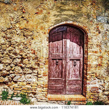 Wooden Door In A Brick Wall In Hdr
