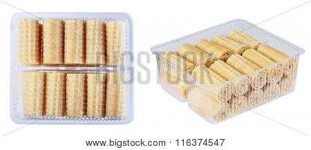 Wafer Rolls In A Plastic Container, Isolate On A White Background In Various Angles.