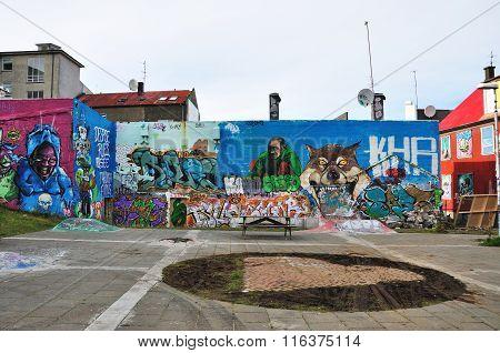 Reykjavik, Iceland - September 22, 2013: Colorful Graffiti Art Line The Street Walls And Back Alleys
