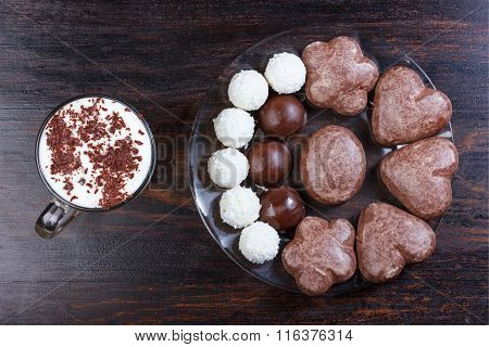 Cappuccino With Chocolate Chips, Coconut Candy, Chocolate Candy On Wooden Table.
