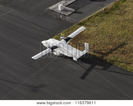 Single Engine Airplane on a airport runway ready for taking off