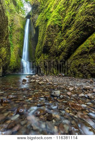 hiking to the waterfalls in Oneonta Gorge trail Oregon.