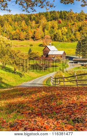 Wooden Barn In Fall Foliage Landscape In Vermont Countryside