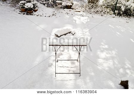 Snow Covered Table In The Garden In Winter