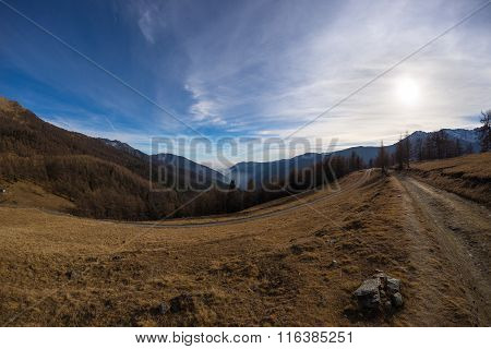 Mountain Winding Road On The Alps In Backlight