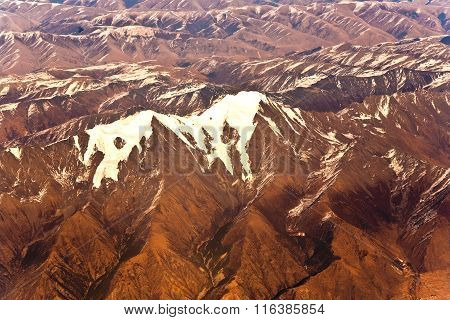 View From The Aircraft To The Mountains Of The Himalaya On Chinese Tibetan Side Snow