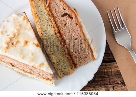 Two Slices Of Cake And The Fork