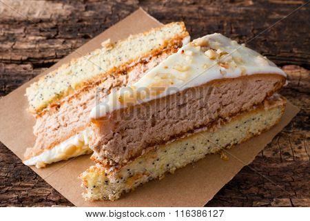 Homemade Cake On A Paper On The Wooden Background