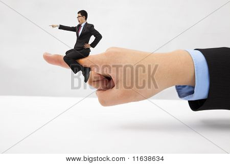 Businessman sitting on the finger shouting and blaming