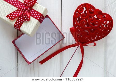 Velvet Heart With A Bow Near The Gift Box On A White Background