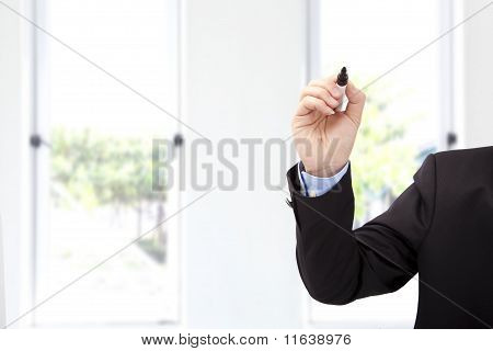 Close up of businessman hand with pen ready to write something