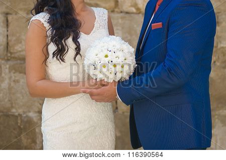 Beautiful bride with bouquet before wedding ceremony