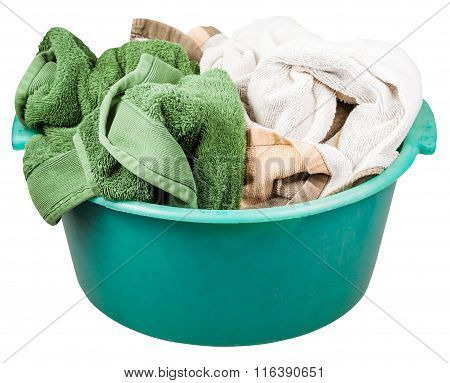 Green Plastic Wash Basin With Towels Isolated