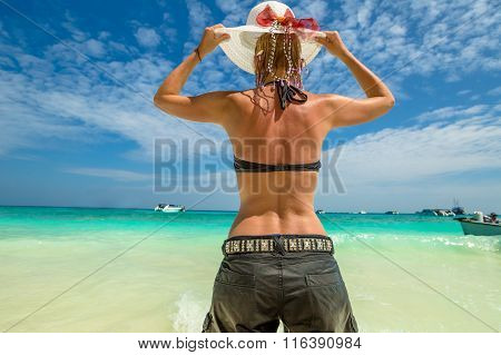 Woman looking tropical sea