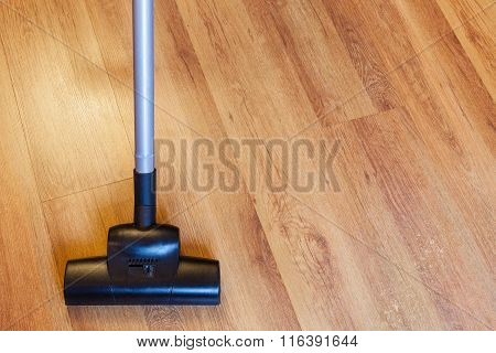 Front View Vacuuming Of Laminate By Vacuum Cleaner
