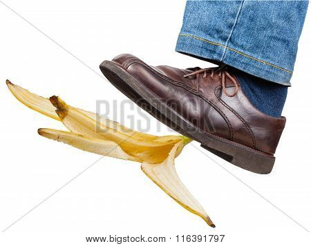 Left Leg In Jeans And Shoe Slips On Banana Peel
